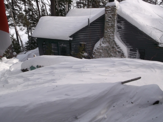 Snow drift is higher than woodpiles